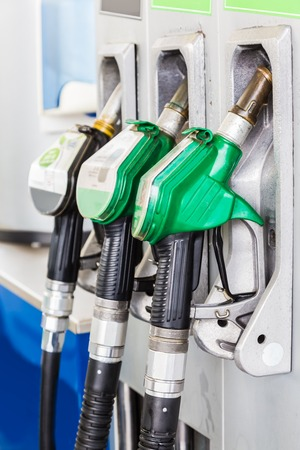 Green gasoline and black diesel distributor at the gas station Stockfoto