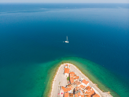 Aerial view of old town Piran. Splendid summer day on Adriatic Sea. Beautiful cityscape of Slovenia, Europe. Traveling concept background. Magnificent Mediterranean landscape.