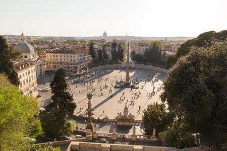 Aerial view of people, sculptures, fountain and churches on Piazza del Popolo in Rome, Italy. Landmarks of eternal city of Rome. Stock fotó