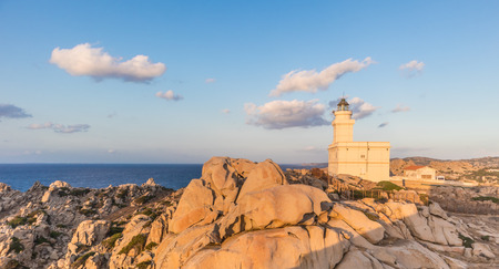 Lighthouse on granite rock formations at Capo Testa, Sardinia, Italy in sunset.