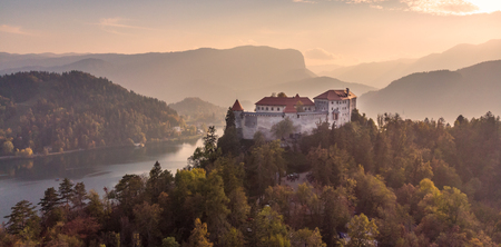 Aerial view of medieval castle by the lake Bled in Slovenia. Beautiful nature of Slovenia in fall.