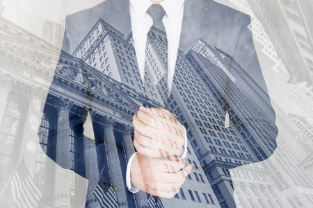 Corporate business, finance, stock market and economic prosperity conceptul collage. Businessman wearing fashionable classic navy blue suit against new york stock exchange. Stockfoto