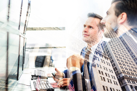 Corporate business, finance, stock market and economic prosperity conceptul collage. Wall street brokers and wealth managers against new york stock exchange window reflection. Stock Photo