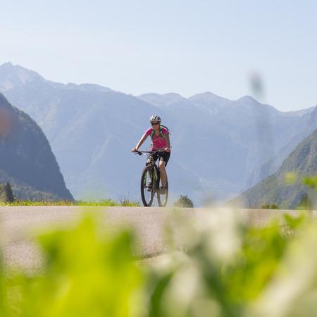 Active sporty woman riding mountain bike in the nature, Slovenia. Stok Fotoğraf