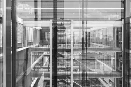 Abstract window reflections in morden office building. Contemporary corporate business architecture. Black and white photo.