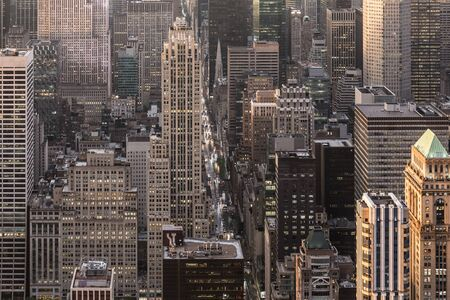 Aerial view of New York City skyline with 5th Avenue at Manhattan midtown. Urban skyscrapers at dramatic after the storm sunset, USA.
