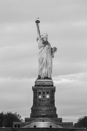 Statue of Liberty at dusk, New York City, USA. Black and white image.