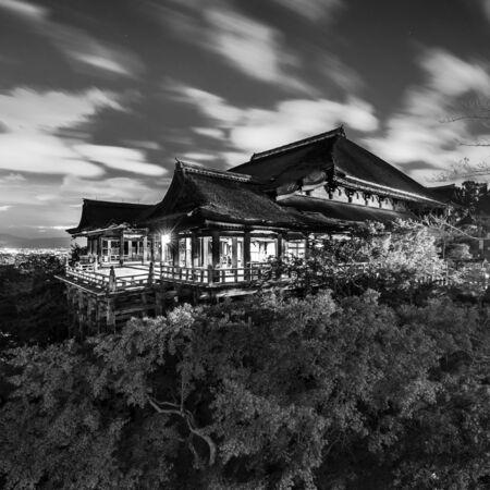 Black and white night photo of Kiyomizu-dera Temple in Kyoto, Japan.