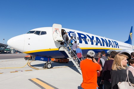 Trieste airport, Italy - 20 April 2018: People boarding Ryanair plane on Friuli Venezia Giulia Airport in Trieste, italy on April 20th, 2018. Ryanair is the biggest low-cost airline company in Europe. Editöryel