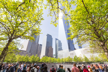 New York City, USA - May 18, 2018: People visiting 9 11 memorial park in downtown Manhattan, located on the site as the original World Trade Center, on 18th of May, 2018, New York City, USA.