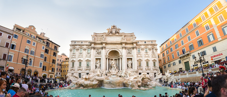 Rome, ITALY - Apr 22, 2018: Crowds of tourists visiting the Trevi Fountain on April 22th, 2018 in Rome. Trevi Fountain is most iconic fountains in world and one of Italys top tourism destinations.