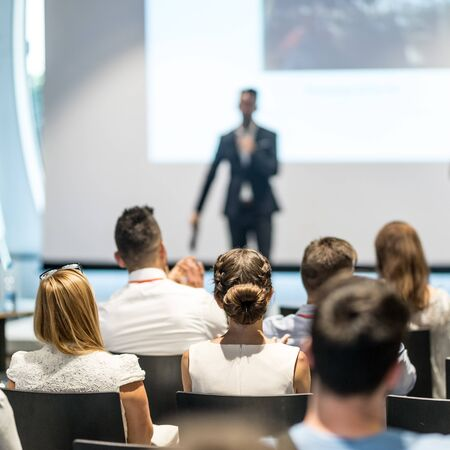 Male speaker giving a talk in conference hall at business event. Audience at the conference hall. Business and Entrepreneurship concept. Focus on unrecognizable people in audience. Foto de archivo - 150374593