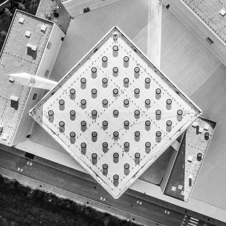 Top aerial view of modern archiecture of islamic religious cultural centre in Ljubljana, Slovenia, Europe. Black and white image.