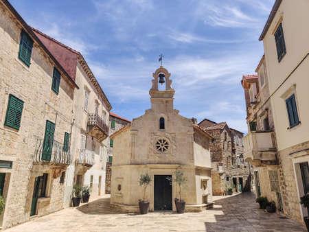 Small church on square of small urban village of Stari grad on Hvar island in Croatia, Adriatic Sea, Europe.