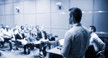 Speaker Giving a Talk at Business Conference and Presentation. Imagens