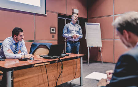 Business speaker giving a talk at business conference meeting event. Imagens