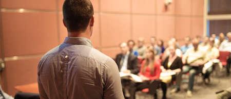 Public speaker giving talk at Business Event. Imagens