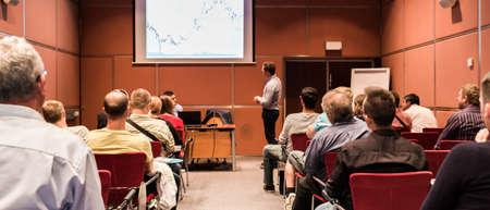 Business speaker giving talk at business conference event. Imagens
