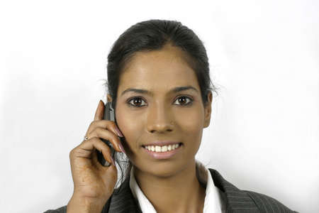 young indian business woman talking on mobile phone