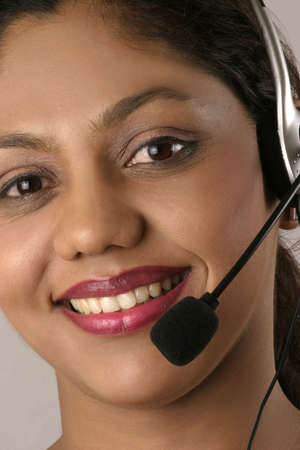 young Indian help desk woman with smile photo