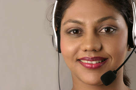 young indian girl with headset
