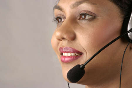 young Indian help desk woman with smile