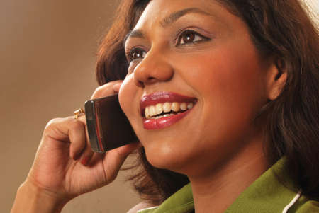 beautiful indian woman on mobile phone