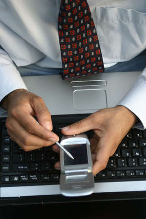 young executive using touch screen mobile phone Stock Photo