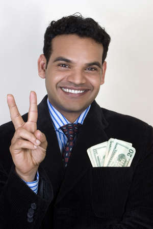 Successful man giving two advice for making money Stock Photo