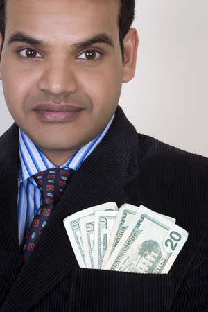 Successful Indian with money in pocket Stock Photo