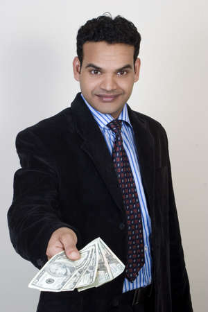 Young successful business man with money photo