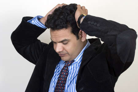 Young Indian shakes head in despair Stock Photo