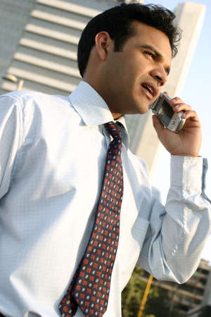 successful young indian doing business on the move  photo