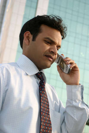 Indian executive talking on mobile phone photo