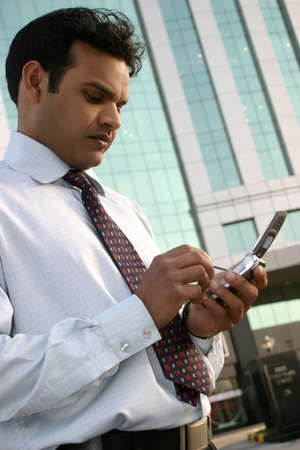 Indian executive using mobile phone Stock Photo