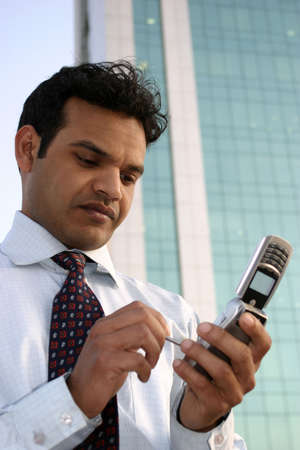 Young Indian executive calling on mobile