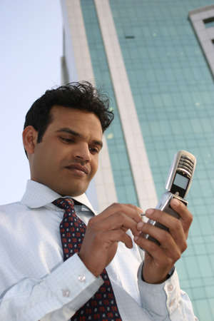 Young Indian Business man using a mobile phone