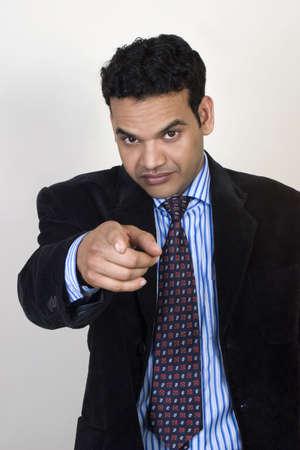 angry teacher: Angry young man Pointing The Finger, with white background Stock Photo