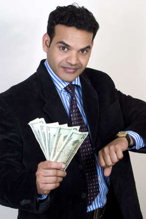 Young Business man with money and watch, concept for time is money photo