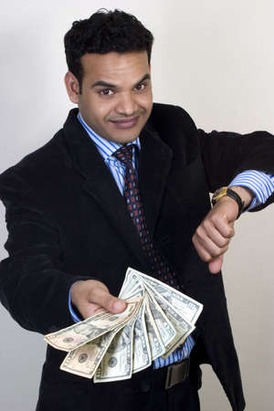 earn money: Young Indian man with money, Time is money concept