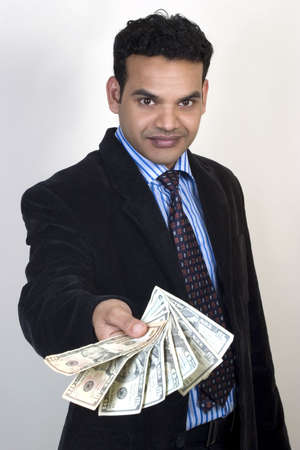 indian money: young man giving money,  Stock Photo