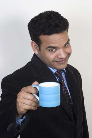 Indian executive offering coffee Stock Photo