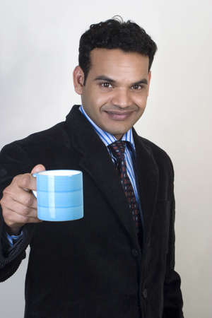 Young   Indian Business man taking coffee break