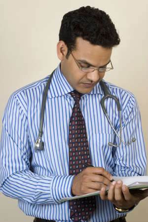 Doctor writes down your treatment Stock Photo