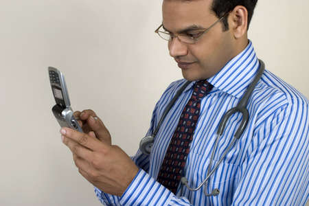 young doctor taking a call on his mobile phone