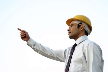 Business man pointing his finger out and looking ahead photo