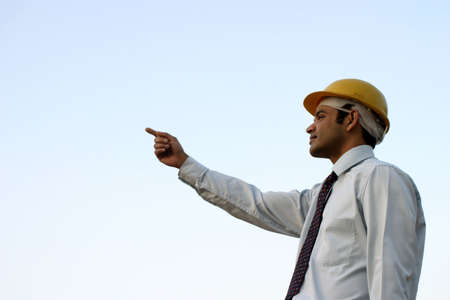 Successful indian businessman with vision, pointing towards future photo