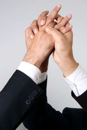 Closeup of   hands raised together in agreement