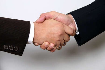 Two business men shaking hands, close up Stock Photo