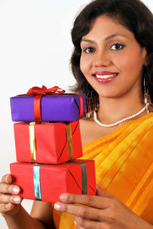 Young Indian woman with lots of gifts